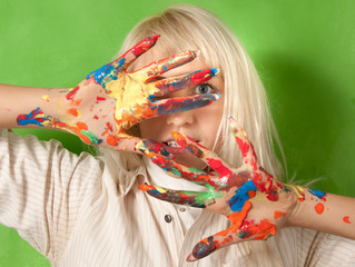 attractive woman with hands in fresh paint