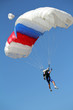 extreme sport parachutist on blue sky