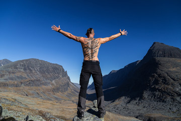Men with Tattoo and Mowhawk in the Mountains