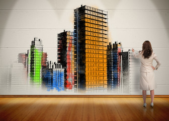 Businesswoman painting colorful city on wall