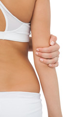 Young fit woman touching her elbow