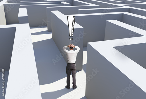 Rear view of desperate businessman standing in maze