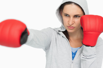 Brunette in sweatshirt boxing