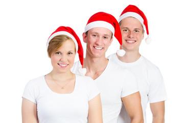 personen mit weihnachtsmützen freigestellt