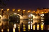 old stone bridge through the river Ebro in Zaragoza, Spain