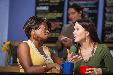 Diverse Friends Talking in Cafe