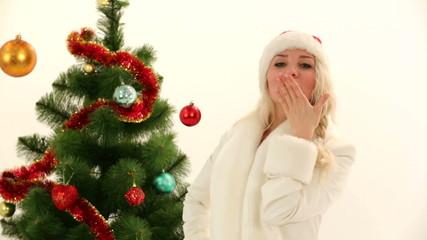 Woman dressed as Santa posing for camera