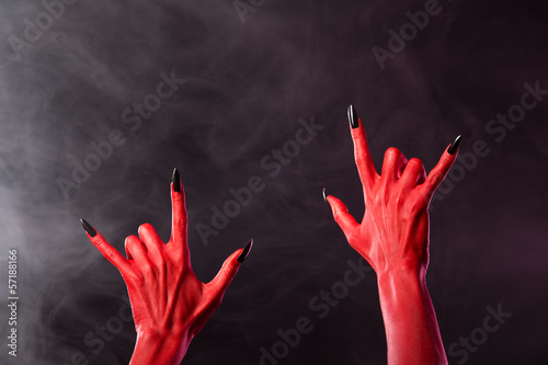 Red devil hands showing heavy metal gesture