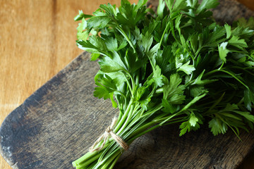 bunch of fresh parsley on an old chopping board