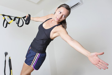 Woman doing trx suspension training