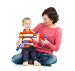 Mother and baby boy play with musical toys