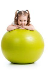 Kid girl having fun with  gymnastic ball isolated