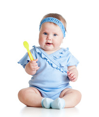 baby girl with a spoon