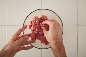 Cook hands making meatballs