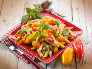 pasta with capsicum and basil, selective focus