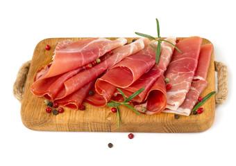 sliced prosciutto on a wooden board