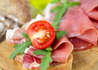 bread with sliced prosciutto crudo