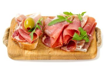 bread with sliced prosciutto crudo