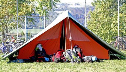 tent of boy scout camp and the rucksack put out in the open air