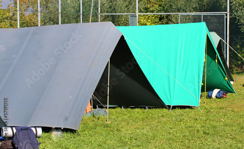 tents for sleeping installed on a campsite on a sunny day