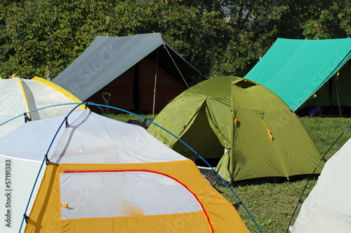 encampment of tents in a soccer field to collect people