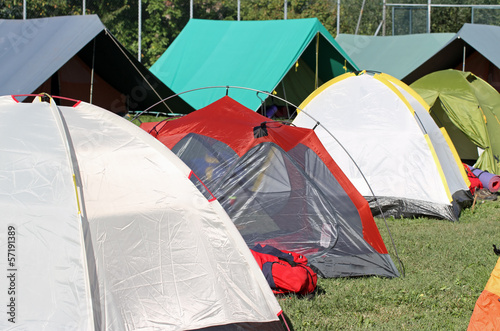 encampment of tents in a soccer field