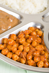 Chana Masala - Spicy chickpea curry served with in a thali.