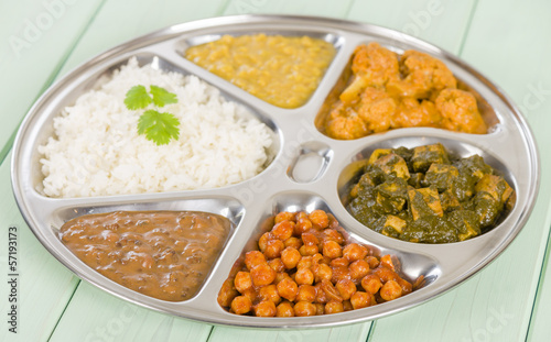 Thali - Vegetarian curries and rice in a traditional dish