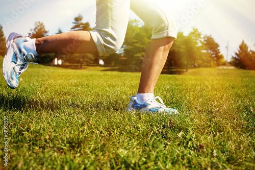 Feet of running woman.