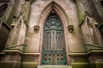 Wood door on imposing old gothic church