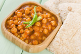 Chana Masala - Spicy chickpea curry served with chapatis.