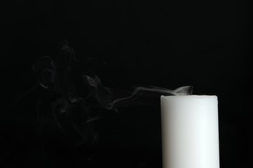 Smoke Coming from Candle on Black Background with Copy Space