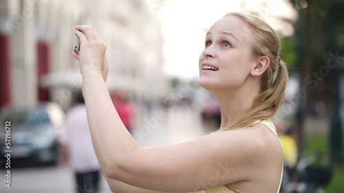 Woman taking a photo while sightseeing