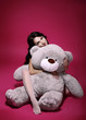 Dreaminess. Sentimental Girl with Soft Toy Gray Bruin in Embrace