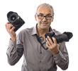 Happy photographer showing his professional cameras on white