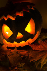halloween pumpkin with candles and leaves