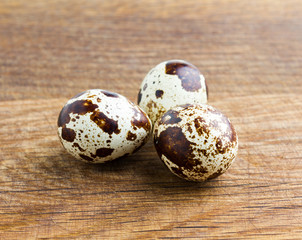 Quail eggs on wooden desk