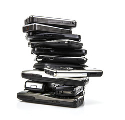 Pile of old mobile phones ready for recycling