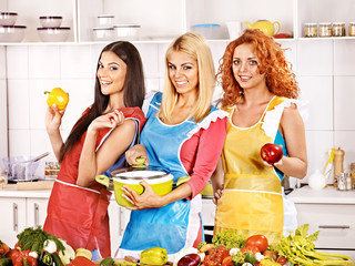 Group women preparing food at kitchen.