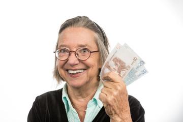 Alte Frau mit Geldscheinen