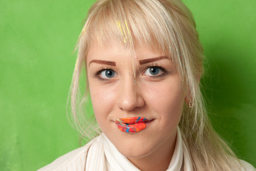 attractive smiling girl with lips in bright paints