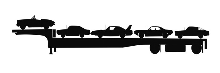cars in silhouette on trailer for transport