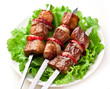 Grilled kebab (shashlik) on spits.