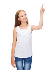 girl in blank white shirt pointing to something