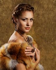Woman in luxury golden fox fur coat, retro style