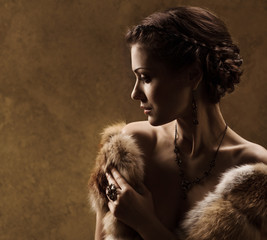 Woman in luxury fur coat, retro vintage style