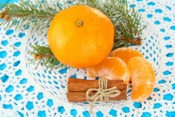 Tasty mandarines on napkin on blue background