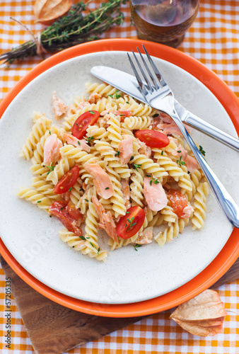 Fusilli pasta with smoked salmon and tomatoes