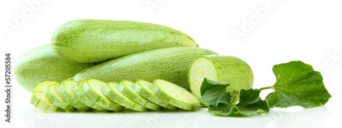 Sliced raw zucchini, isolated on white