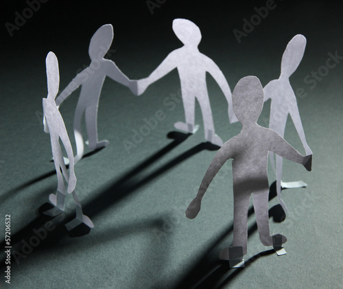 Paper people in social network concept on dark background